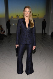 Julie Henderson sported a '70s vibe in a navy pantsuit during the Pamella Roland fashion show.