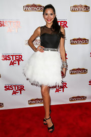 Joyce Giraud brought out the glitz and the glam with this black and white cocktail dress that featured a bedazzled belt and a full feathered skirt.