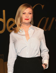 Kirsten Dunst showed off her Panthere watch while attending the Cartier party in LA.