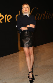 Dree Hemingway gave her preppy top some edge with a black leather mini skirt.