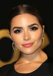 Olivia Culpo wore her hair in a tight, center-parted bun at the Panthere De Cartier party.