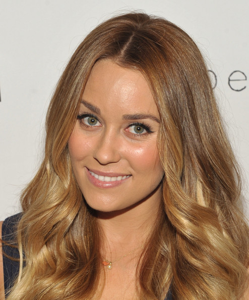 Lauren Conrad chose a simple, retro eye makeup look for Fashion's Night Out in Los Angles. Her technique involves sweeping black liquid liner across upper lids, beginning at the inner corners and ending just past the outer corners. Lots of mascara finishes off the look.