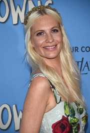 Poppy Delevingne amped up the fairy-tale feel with a gold tiara.