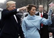 Melania Trump kept warm with a pair of pastel-blue suede gloves that matched her skirt suit during the Presidential Inauguration parade.