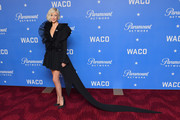 Andrea Riseborough made a dramatic entrance in a frilly black Ronald van der Kemp dress with an ultra-long train at the world premiere of 'Waco.'