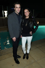 Michelle Rodriguez teamed white skinny pants with a black top and a studded leather jacket for a special event hosted by Paramount Pictures.