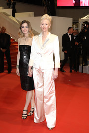 Tilda Swinton kept it simple yet stylish in an ivory satin pantsuit by Chanel at the 2019 Cannes Film Festival screening of 'Parasite.'