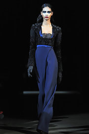 Chanel donned a blue silk jumpsuit with a sparkling overlay for the Givenchy Couture fashion show.