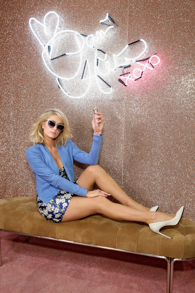 Paris Hilton Suede Jacket [blond,leg,beauty,sitting,pink,wall,footwear,long hair,human leg,thigh,new york city,jacob javits center,beautycon festival nyc,paris hilton]