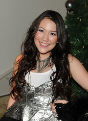 Manika wore her shiny tresses in long, loose curls at Paris Hilton's Electric Christmas holiday party.