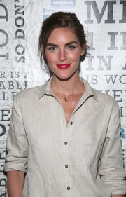 Hilary Rhoda swiped on some bold red lipstick for a jolt of color to her neutral outfit.