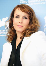 Noomi Rapace made her eyes stand out with metallic silver shadow when she attended the 'Passion' photocall.