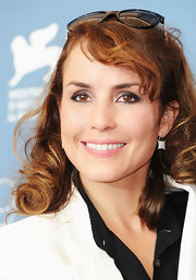 Noomi Rapace wore a charming pair of square-shaped diamond earrings to the 'Passion' photocall.