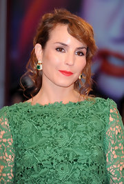 Noomi Rapace paired dangling emerald earrings with her green lace dress for a stunning finish at the 'Passion' premiere.