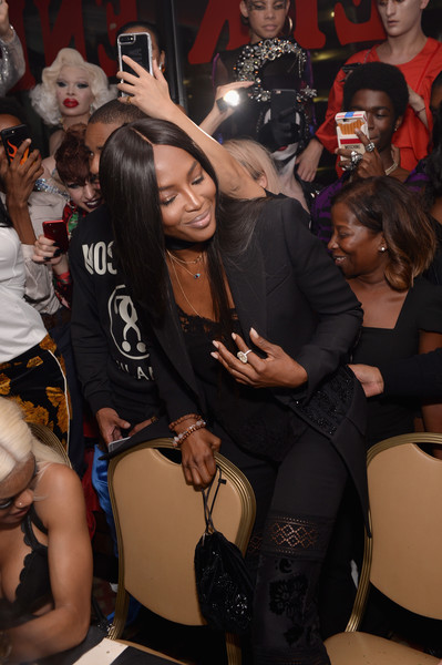 Naomi Campbell attended the Pat McGrath Unlimited Collection launch sporting a black velvet pouch and pantsuit combo.