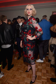 Gwendoline Christie looked coquettish in a sheer, floral-embroidered midi dress at the Pat McGrath Unlimited Collection launch.