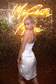 Hailey Baldwin slipped into a little white satin dress by Meshki for the Pat McGrath Unlimited Collection launch.
