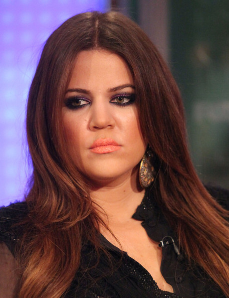 Khloe Kardashian visited the Fox and Friends studios wearing deep purple shadow. She exaggerated her smoldering eyes by rimming her upper and lower lids in black liner.