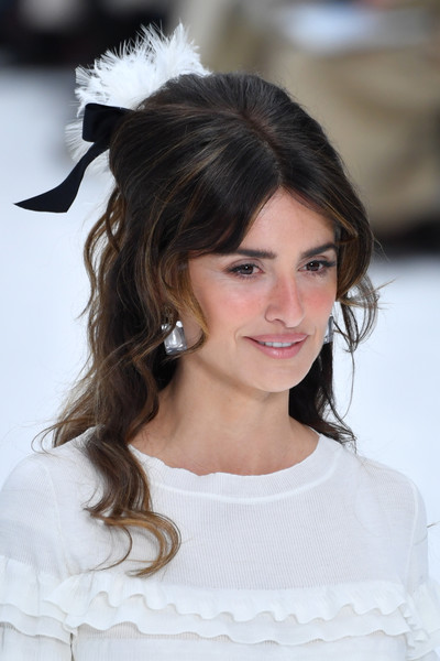 Penelope Cruz Half Up Half Down [hair,white,face,hairstyle,lady,beauty,eyebrow,chin,skin,long hair,penelope cruz,runway - paris fashion week womenswear fall,part,runway,paris,france,chanel,show]