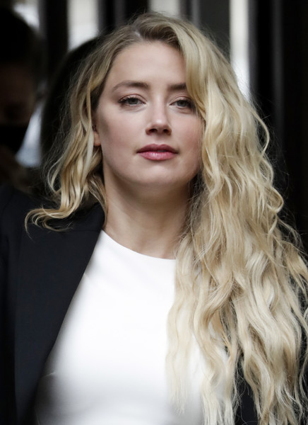 Amber Heard wore her hair in blonde mermaid waves during Johnny Depp's libel trial.