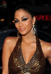 Nicole is a golden goddess with her bronze gown, tanned skin and these gorgeous dangling gold and crystal earrings.