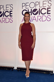 Bellamy Young kept it minimal in a racer-neckline red dress at the People's Choice Awards nominations press conference.