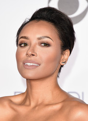 Kat Graham kept her beauty look understated with nude lipstick.