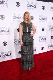 Claire Danes went for subtle sexiness in a black Burberry gown with metallic threading, a slashed bodice, and an open back during the People's Choice Awards.