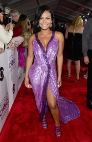 Christina Milian donned a cleavage-and-leg-baring sequin gown in two shades of purple for her People's Choice Awards look.