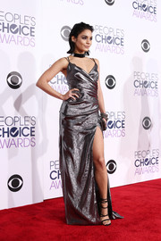 Vanessa Hudgens ravished in a silver Kayat wrap gown with an ultra-high slit during the People's Choice Awards.