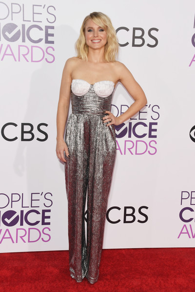 Kristen Bell looked totally disco-ready in a Rasario strapless jumpsuit, in silver with contrast cups that she paired with Eva Fehren jewelry at the 2017 People's Choice Awards.