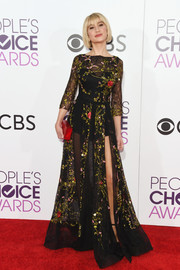 Chelsea Kane struck the perfect balance between sexy and classy with this sheer, high-slit floral gown at the 2017 People's Choice Awards.