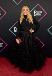Busy Philipps added a bright spot with a textured pink box clutch by Lala Lexa.