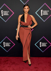 Shay Mitchell hit the 2018 People's Choice Awards wearing a russet and black halter gown by Maticevski.
