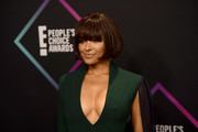 Kat Graham attended the 2018 People's Choice Awards wearing a classic bob with eye-grazing bangs.