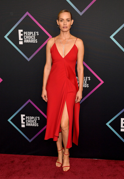 Amber Valletta complemented her dress with red skinny-strap heels.