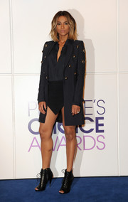 Ciara tamed her too-short skirt with a super-chic studded black coat when she attended the People's Choice Awards nominations press conference.