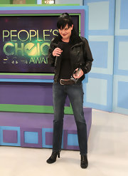 Pauley wears a pair of classic blue jeans with a leather jacket.