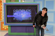 Actress Pauley Perrette poses with a People Choice award during the People's Choice Awards Showcase on