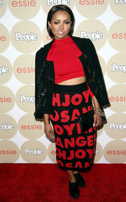 Kat Graham went for an edgy yet fun feel with a black and red Joyrich skirt teamed with a crop-top and a jacket when she attended People's Ones to Watch party.