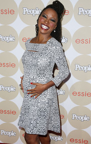Shanola Hampton chose a printed maternity dress with peekaboo detailing for the Ones to Watch party.