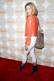 Dawn Olivieri sported a striking color combination with her blue ankle boots and red leather jacket combo at the Ones to Watch party.