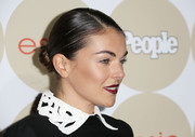 Serinda Swan attended People's Ones to Watch party wearing her hair in a sleek bun.