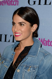 Nikki Reed contrasted her rugged outfit with a very elegant center-parted chignon when she attended the People StyleWatch Denim Awards.