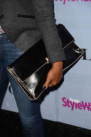 Garcelle Beauvais accessorized with a simple yet smart oversized black clutch when she attended the People StyleWatch Denim Awards.
