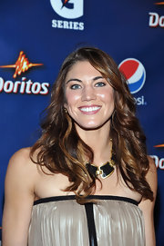 Hope Solo attended the Pepsi Pre-Super Bowl Party wearing her long shiny locks in tousled curls.