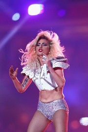 Lady Gaga matched her top with a pair of rhinestone-encrusted hot pants, also by Versace.