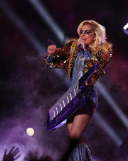 Lady Gaga went all out with the sparkle at the Super Bowl halftime show, teaming a spiky-shouldered gold paillette jacket by Atelier Versace with a silver crystal bodysuit.