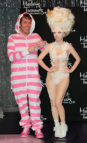 Wearing a striped pink and white onesie, Perez Hilton almost stole the limelight from Lady Gaga's wax figure.
