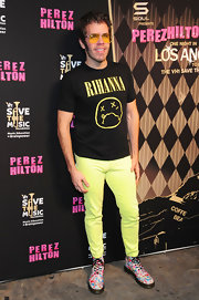 Perez Hilton's colorful Dr. Martens boots and neon yellow skinnies made for a vibrant get-up.